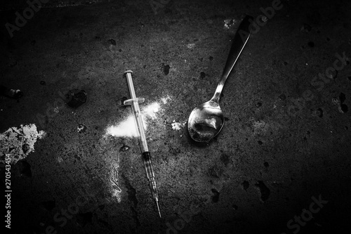 Heroin syringe on rough concrete, dirty background Canvas Print