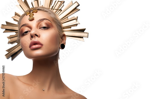 Portrait of beautiful young woman wear in sun disc crown with beautiful healthy skin, stylish makeup, full lips and blonde hair. Art look. Halloween look idea