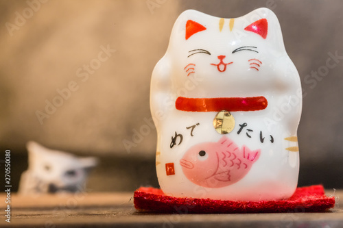 Photographie  cute ceramics happy cat display on table