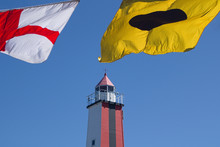 International Signal Flags Wind Against The Sky And The Lighthouse Tower
