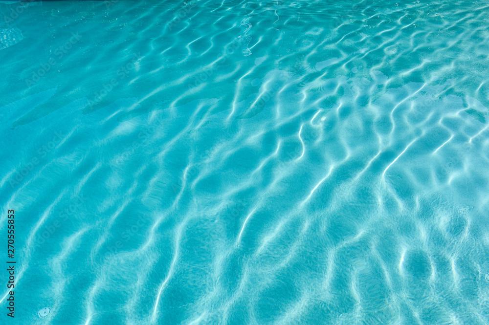Fototapeta Surface of rippled blue swimming pool