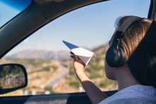 A Girl In The Headphones Is La...