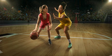 Female Basketball Players Fight For The Ball. Basketball Players On Big Professional Arena During The Game
