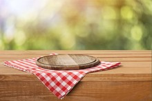 Empty Tray On Tablecloth On Wooden Table