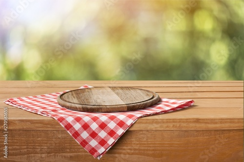 Fototapeta Empty tray on tablecloth on wooden table obraz