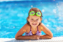 Beautiful Little Girl Swimming At The Pool