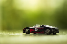 Hot Wheels Toy Car Over Blurred Background