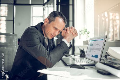 Fototapety, obrazy: Businessman wearing stylish jacket working on financial report