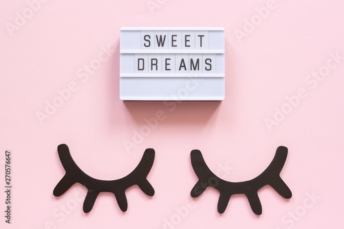 Fotomural  Lightbox text Sweet dreams and decorative wooden black eyelashes, closed eyes on pink paper background