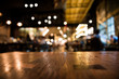 Real wood table and waitress with light reflection on scene at restaurant, pub or bar at night. Blurred background for product display or montage your products with several concept idea.