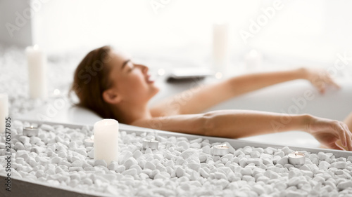 Woman Lying In Bath With Foam And Candles Fototapete