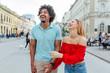 Man and a woman walking through the city, enjoying the beautiful day