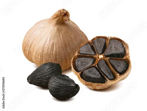 Cuadros en Lienzo Black garlic cloves isolated on white background