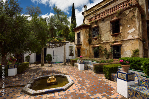 Photo Crumbling Casa del Rey Moro or Moorish Kings house in Ronda Andalusia