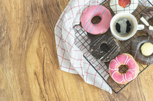 Donuts And Coffee On Wooden Table,top View