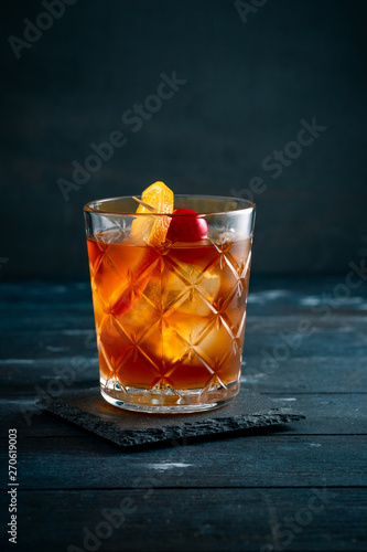 Whiskey sour cocktail with a slice of orange, cherry and ice, a classic alcoholi Canvas Print