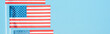 panoramic shot of national american flags on blue background