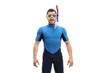Young Man In A Wetsuit With Snorkeling Equipment