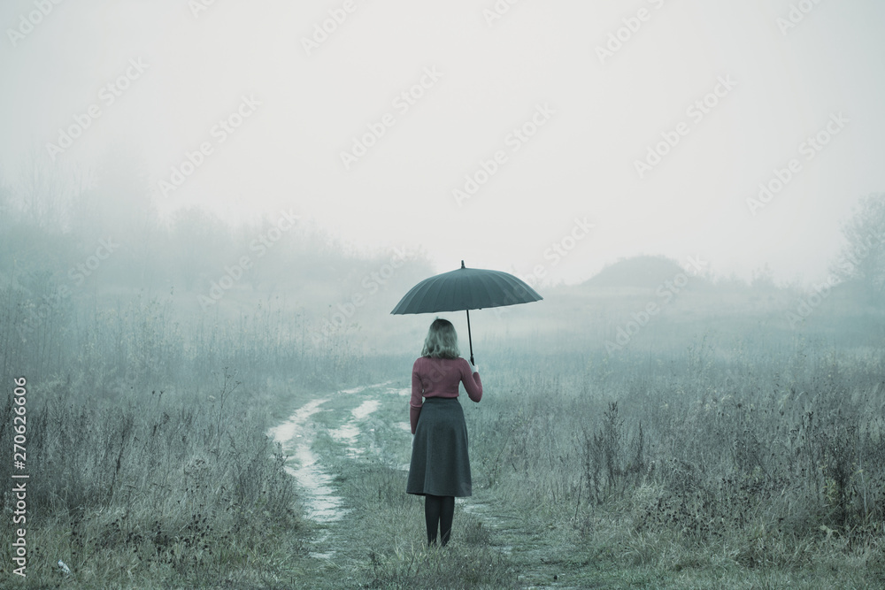 Fototapety, obrazy: young girl with umbrella in autumn field