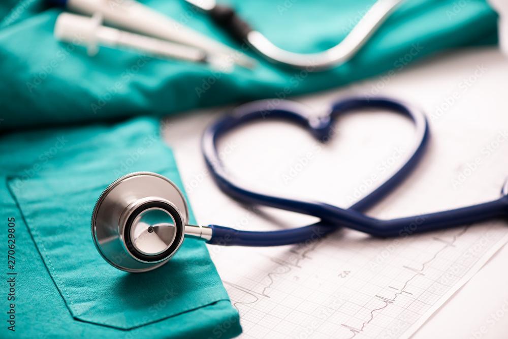 Fototapety, obrazy: Medical stethoscope twisted in heart shape.