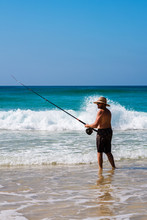 Man Fishing In The Surf