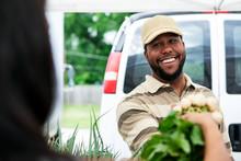 Market: Farmer Helps Woman Buy...