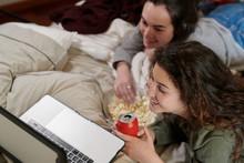Girlfriends Enjoying TV Series...