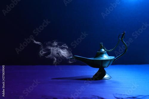 Obraz na plátně  Image of magical mysterious aladdin lamp with smoke
