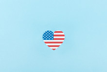 Top View Of Paper Cut Decorative Heart Made Of American Flag On Blue Background