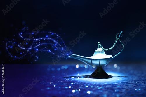 Fotografie, Obraz  Image of magical mysterious aladdin lamp with glitter smoke