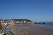 View Of Castle On Hill In Scarborough, UK On A Clear Blue Sky Sunny Day