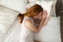 Nordic Woman Sleeping On The Bed.