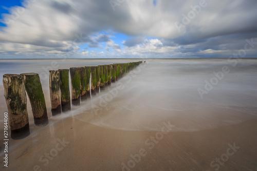 Fototapeten Natur the posts on the beach at Cadzand - The Netherlands