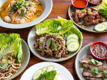 Traditional Northern Thai Food Cooked Fresh. Pork Laab, Larb, Mushrooms, Spicy Chile Soup, Beef Meatballs, Flank Steak, Soft Boiled Egg, Papaya Salad.