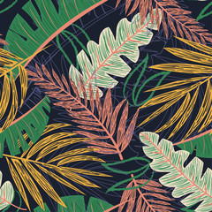 FototapetaBright seamless pattern with tropical leaves and plants on a dark background. Vector design. Jungle print. Textiles and printing.