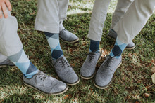 Groomsmen Showing Off Shoes And Socks At Weddig