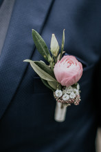 Groom Or Best Man Wearing A Floral Corsage