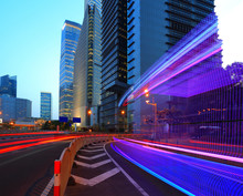 The Highway Car Rainbow Light Trails Of Modern City Buildings
