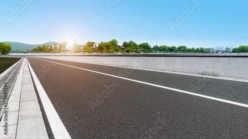Foto auf AluDibond Cappuccino Road Pavement and Natural Landscape of Landscape..