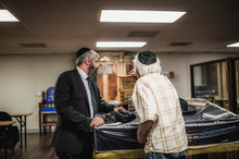 A Jewish Rabbi And A Man In A Synagogue