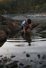 Boy Looking At Tide Pool