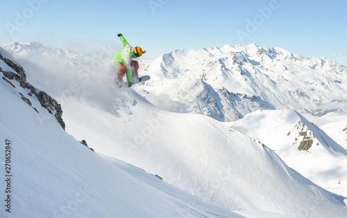 Male snowboarder jumping in the air