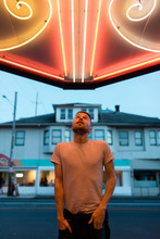 Portrait Of Young Male Under Neon Light