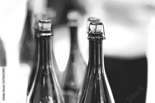 Poster de jardin Bar Glass champagne bottles with stoppers