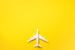 canvas print picture - Travel, vacation concept. White model airplane on yellow color background with copy space. Top view. Flat lay. Minimal style design.