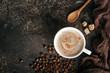 Leinwanddruck Bild - Coffee board with coffee beans on dark textured background.