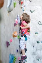 Cute Little Girl Rock Climbing