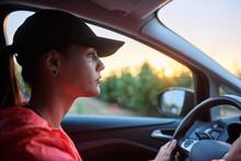 Sportswoman Driving Car In Sun...
