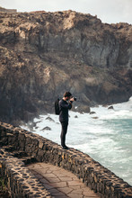 Photographer Taking Pictures From A Cliff