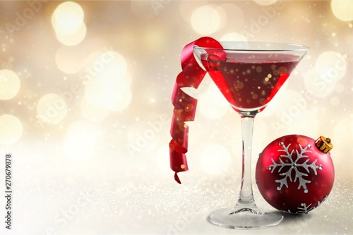 Poster Nature Glass of red wine and Christmas decoration on background